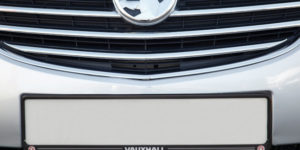 Black Front Number Plate Surround with Vauxhall logo